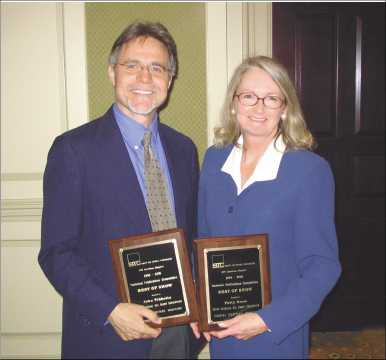 John Tibbetts, editor, and Patty Snow, art director, accept the Award of Distinction and Best of Show at the Carolina Chapter Awards Banquet in March, 2005.