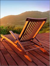 Photo of lounge chair at sunset.